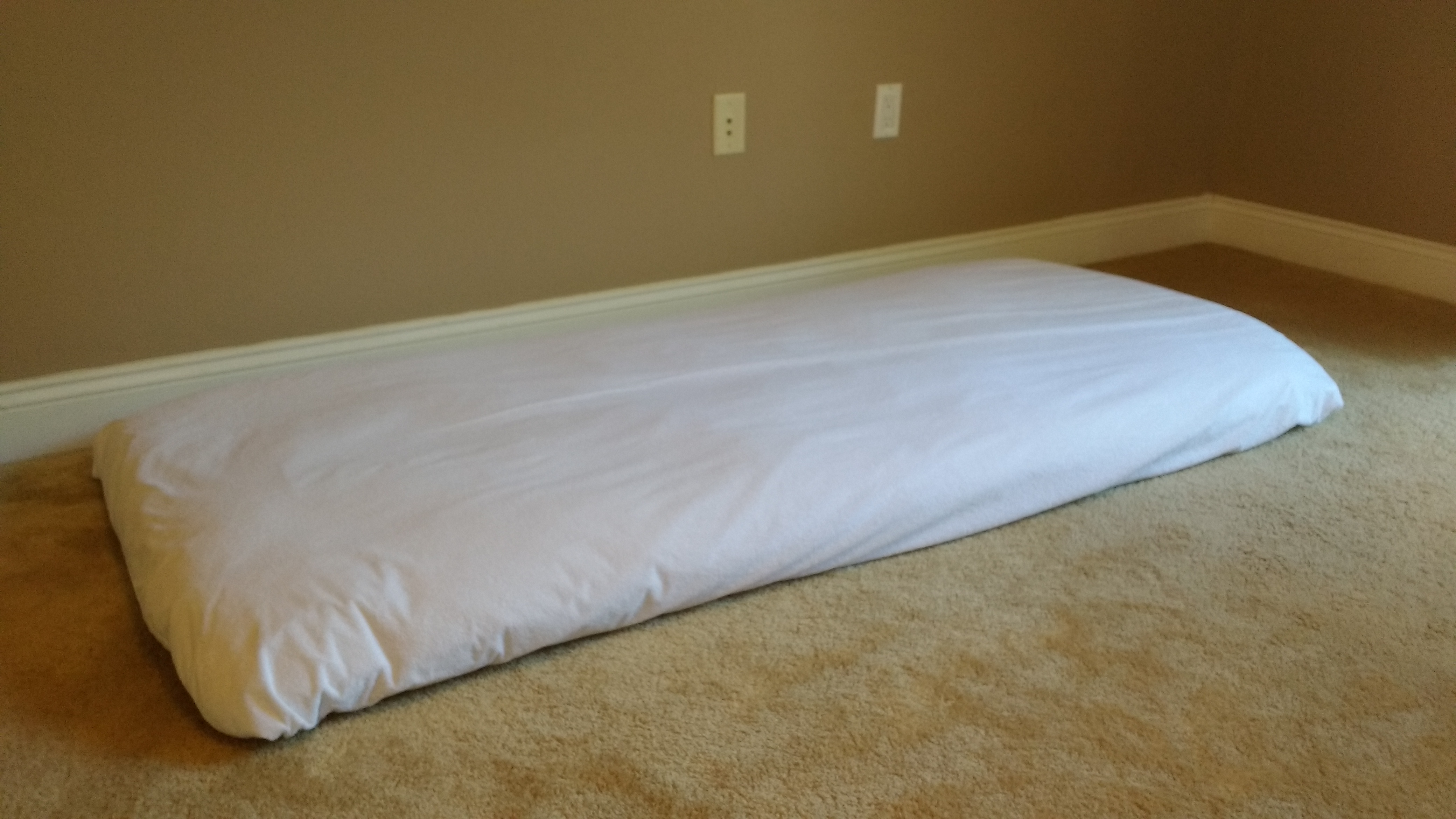 kids futon with plastic sheet cover